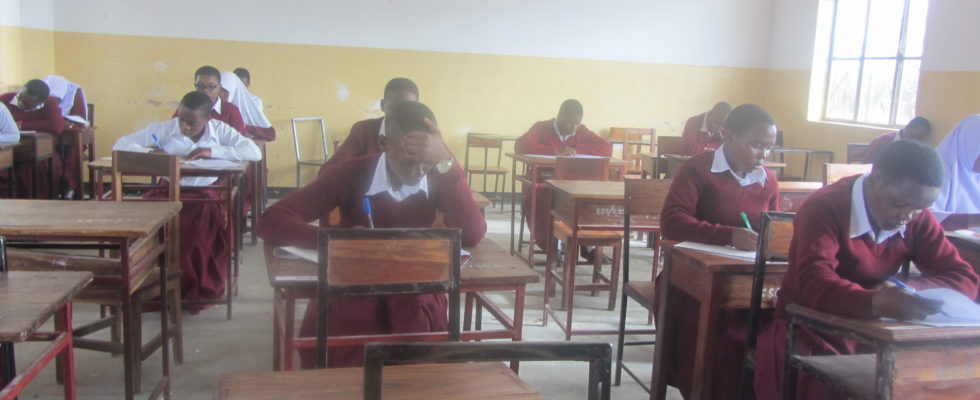 Form Five students sitting for their annual assessment examination at Chamwino High School