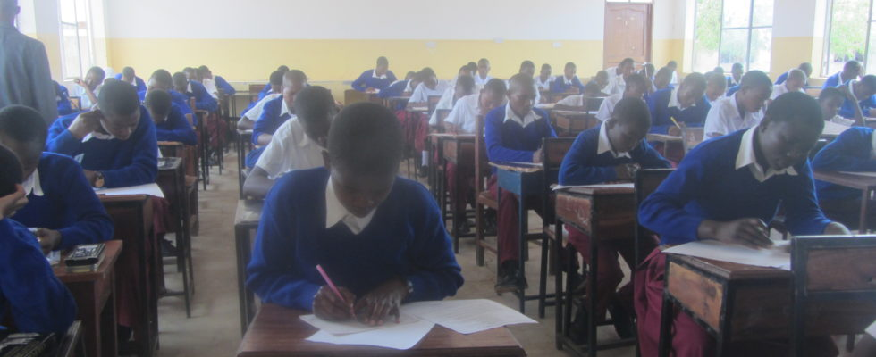 Form one students sitting for their annual assessment examination
