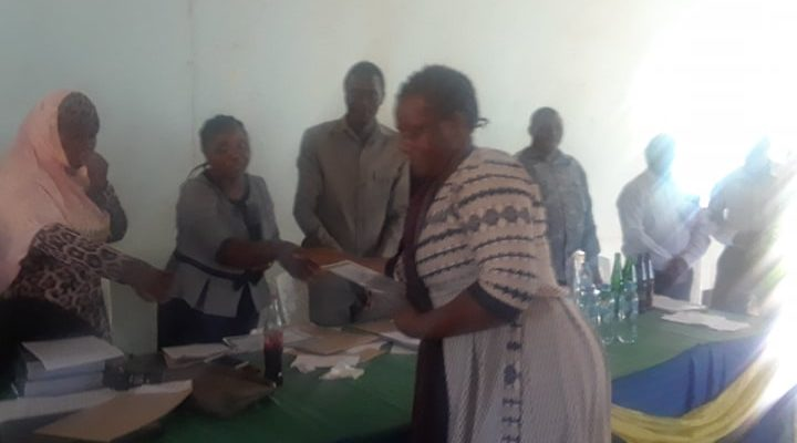 CAC staff receiving a certificate of appreciation from Chamwino District Council